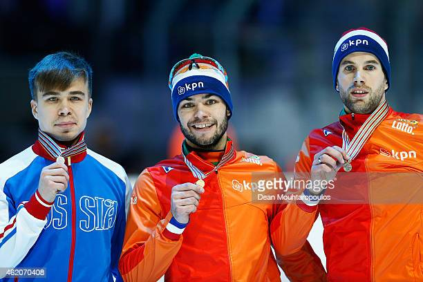 Sjinkie Knegt of the Netherlands #61 Semion Elistratov of Russia and Daan Breeuwsma of the Netherlands pose after the Mens 1500m final during day 2...
