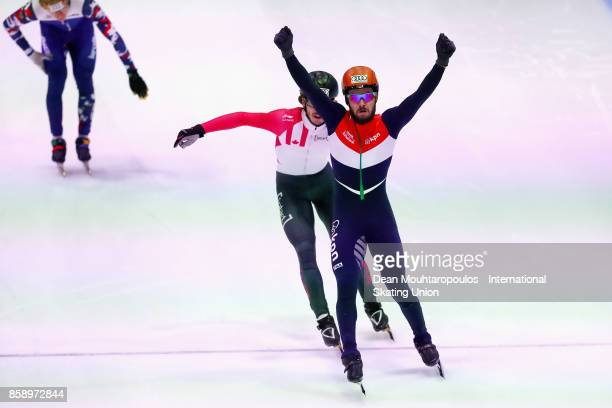Sjinkie Knegt of the Netherlands celebrates crossing the finish line and winning the Mens 1000m Final during the Audi ISU World Cup Short Track Speed...
