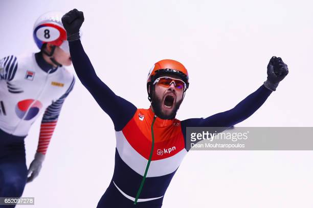 Sjinkie Knegt of the Netherlands celebrates victory and his gold medal after he competes in the 500m Mens Final with silver medalist Wu Dajing of...