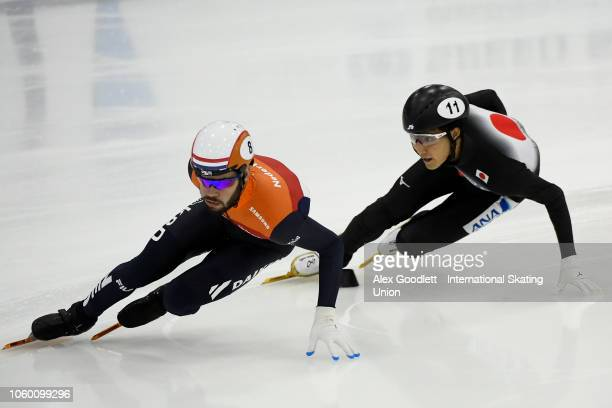 Sjinkie Knegt of the Netherlands leads Kazuki Yoshinaga of Japan in a men's 1500m semifinal during ISU World Cup Short Track Salt Lake City on...