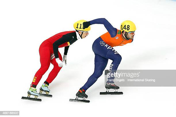 Sjinkie Knegt of the Netherlands leads Tianyu Han of China during the Men's 1500m Semifinal on day two of the ISU World Short Track Speed Skating...