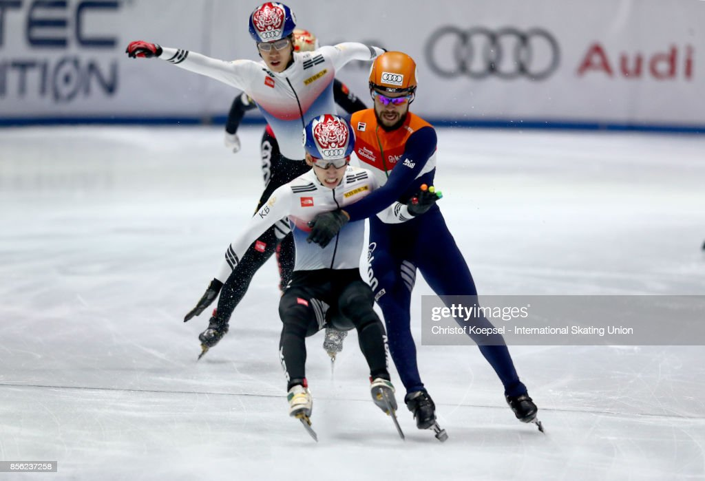 Sjinkie Knegt of the Netherlands (R) pulls winner Jun Hyo Lim of Korea (L) at the finish line down during the Audi ISU World Cup Short Track Speed Skating at Bok Hall on October 1, 2017 in Budapest, Hungary.