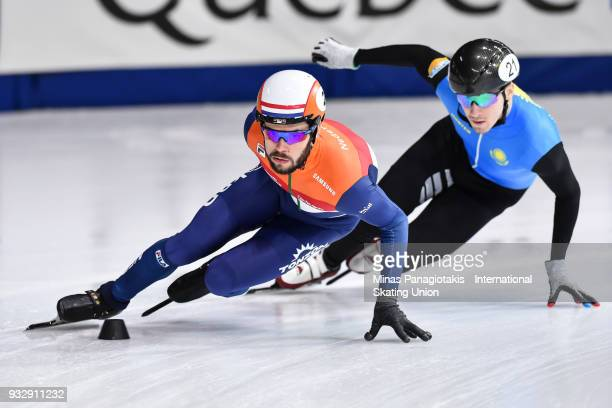 Sjinkie Knegt of the Netherlands skates against Denis Nikisha of Kazakstan in the men's 1000 meter preliminaries during the World Short Track Speed...