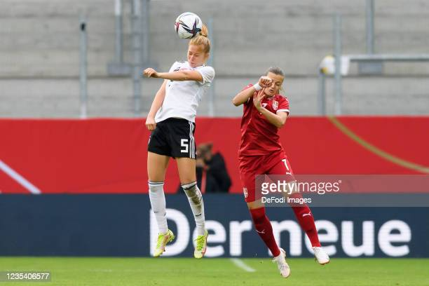 Sjoeke Nuesken of Germany and Milica Mijatovic of Serbia battle for the ball during the FIFA Women's World Cup 2023 Qualifier group H match between...