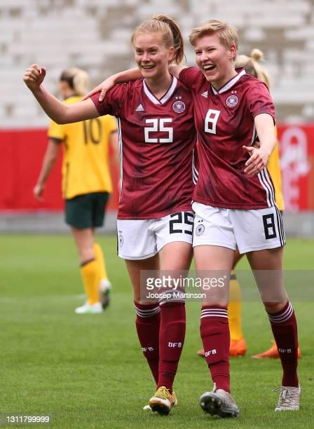 Sjoeke Nuesken of Germany celebrates with teammate Paulina Krumbiegel after scoring her team's first goal during the Women's International Friendly...