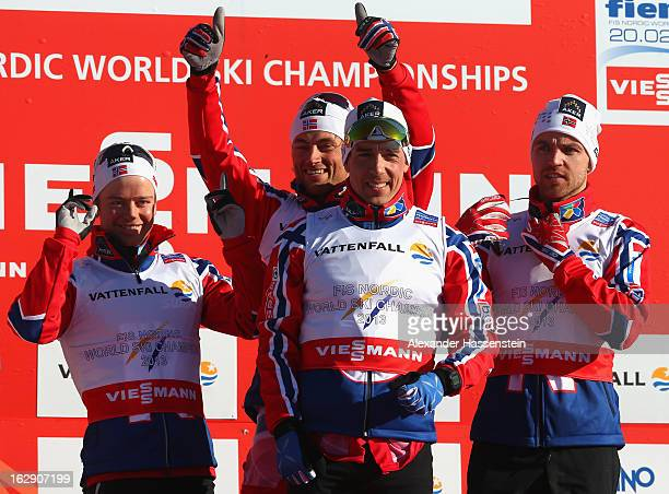 Sjur Roethe, Eldar Roenning, Tord Asle Gjerdalen and Petter Northug jr.of Norway celebrate victory following the Men's Cross Country Relay 4x10 Km at...