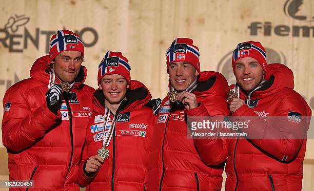 Sjur Roethe, Eldar Roenning, Tord Asle Gjerdalen and Petter Northug jr.of Norway pose with their Gold medals at the medal ceremony for the Men's...