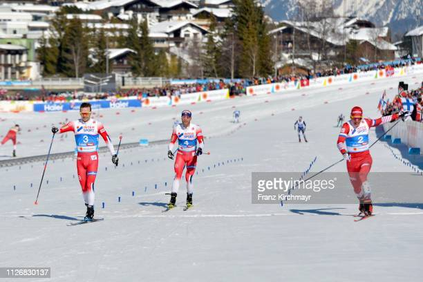 Sjur Roethe of Norway Martin Johnsrud Sundby of Norway and Alexander Bolshunov of Russia during the Men's Cross Country Skiathlon at the FIS Nordic...