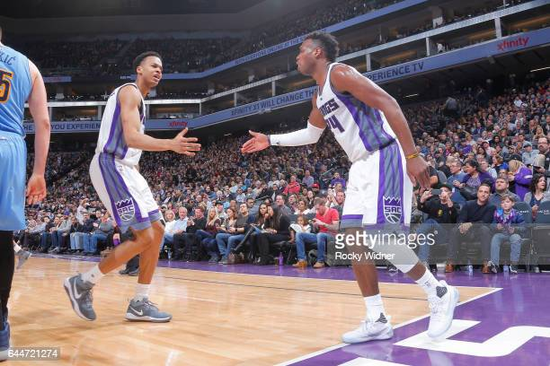 Skal Labissiere and Buddy Hield of the Sacramento Kings celebrate during a game against the Denver Nuggets on February 23 2017 at Golden 1 Center in...