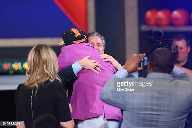 Skal Labissiere is congratulated by Kentucky Wildcats coach John Calipari after being drafted 28th overall by the Phoenix Suns in the first round of...