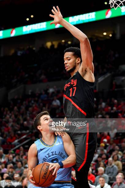 Skal Labissiere of the Portland Trail Blazers stands tall over Dusty Hannahs of the Memphis Grizzlies at Moda Center on April 03 2019 in Portland...