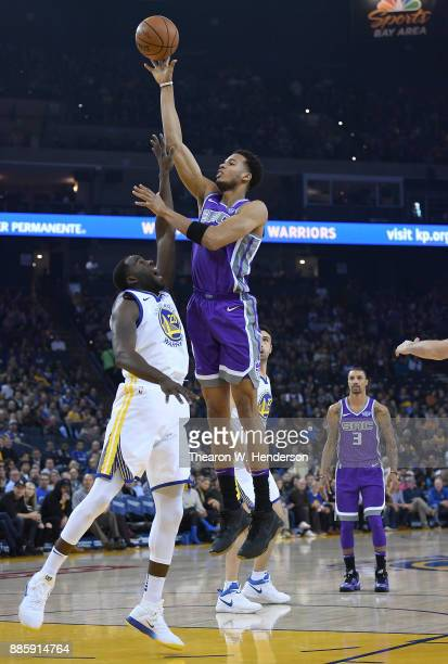 Skal Labissiere of the Sacramento Kings shoots over Draymond Green of the Golden State Warriors during their NBA basketball game at ORACLE Arena on...