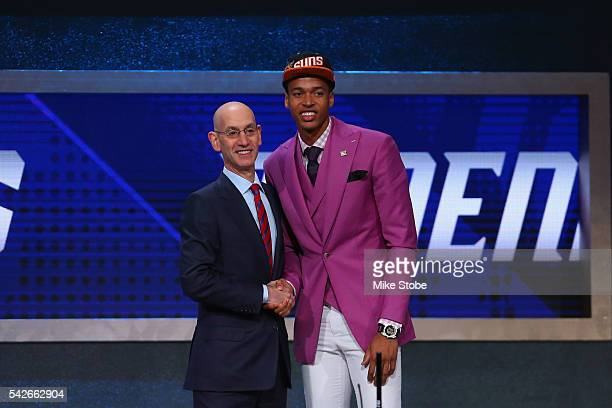 Skal Labissiere shakes hands with Commissioner Adam Silver after being drafted 28th overall by the Phoenix Suns in the first round of the 2016 NBA...