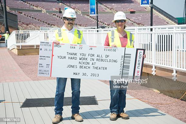 Skanska Prject Workers attend the press preview of the newly restored Nikon At Jones Beach Theater after being damaged by Superstorm Sandy in October...