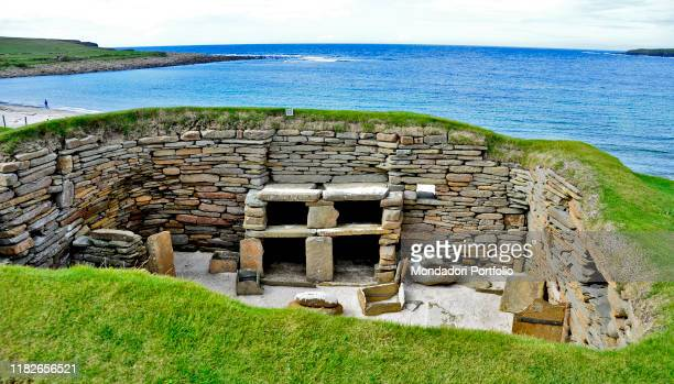 Skara Brae is a stonebuilt Neolithic settlement located on the west coast of Mainland the largest island in the Orkney archipelago of Scotland...