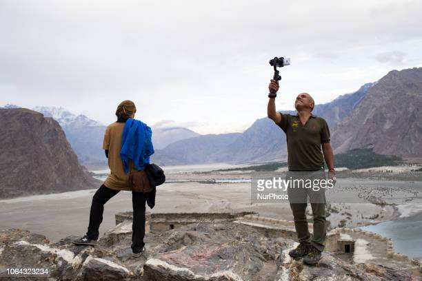 Skardu, Pakistan, 29 September 2018. Tourists can admire the view of the Indus Valley from Kharpocho. The fort and its mosque are located on the...