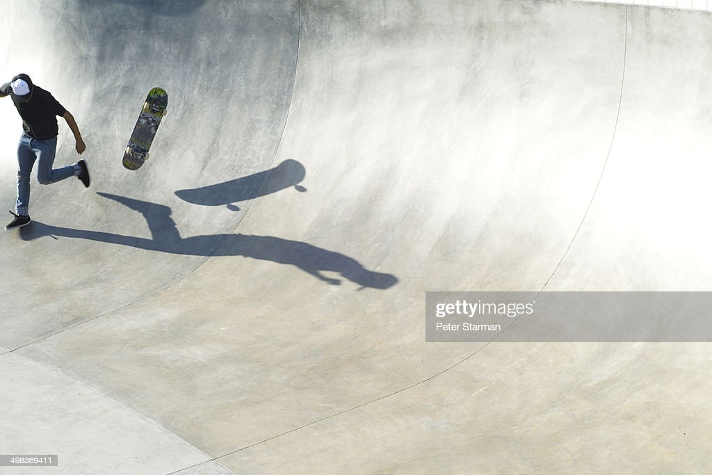 Skate boarder falling off skate baord. : Stock Photo