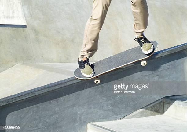 Skate boarders foot work at skate park.