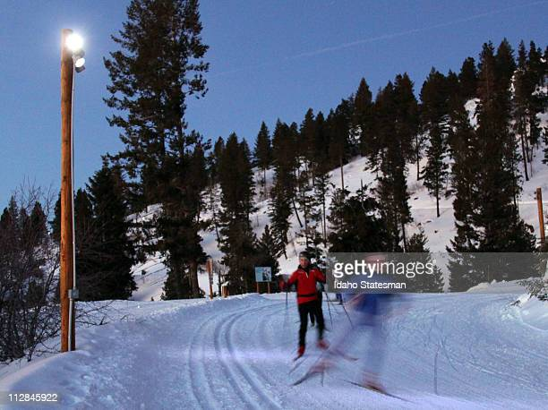 Skate skiers hit the Bogus Nordic trails in the evening under the lights