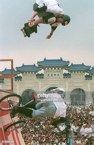 US skateboard athlete Tony Hawk and US BMX biker Matt Hoffman perform 04 June at Taipei's Chiang Kaishek Memorial Hall part of activities launching...