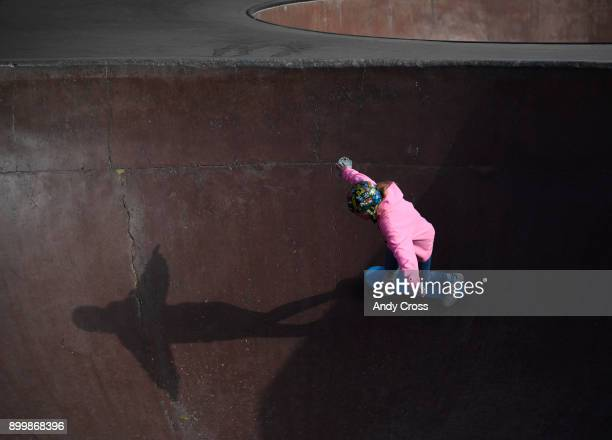 Skateboard enthusiast Julianne MacNichol stabilizes while skating a bowl in temperatures in the low 20's at the Denver Skate Park December 30 2017