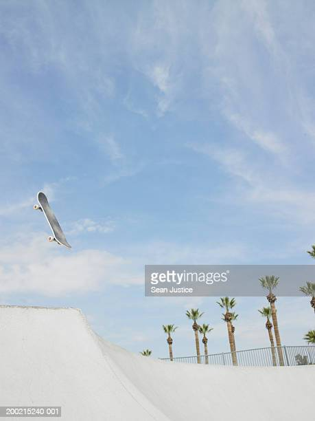 Skateboard in air over course