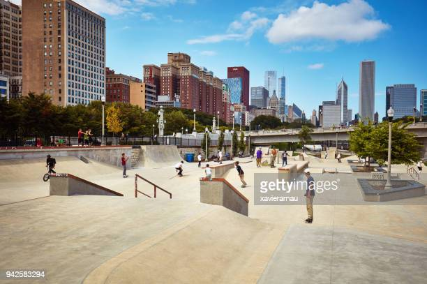skateboard park in chicago - millenium park stock photos and pictures