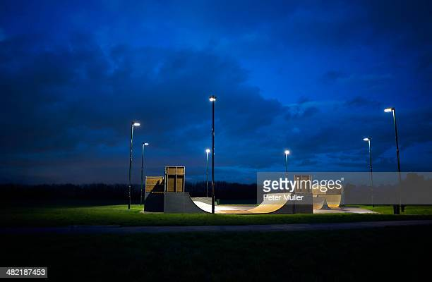 Skateboard park surrounded by a circle of lights at night