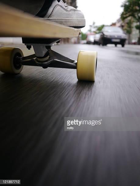 skateboard - longboard skating stock-fotos und bilder