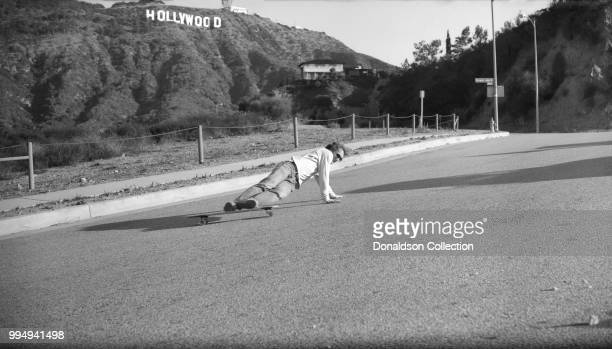 A skateboarder at Lake Hollywood Park in the Hollywood Hills area on December 4 1975 in Los Angeles California