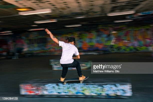 Skateboarder at Southbank Centre Skate Park, London, England.
