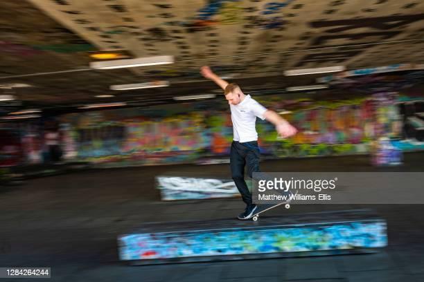 Skateboarder at Southbank Centre Skate Park, London, England.