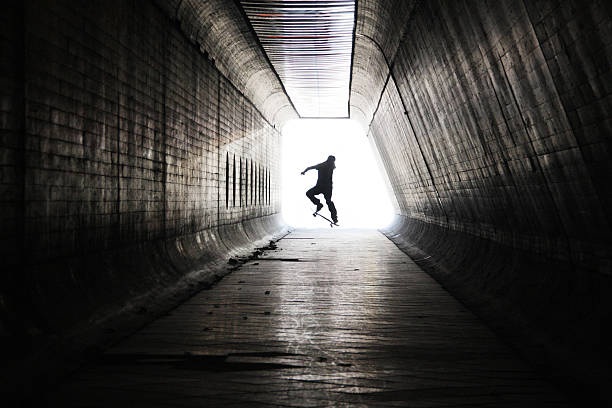 Skateboarder at tunnel