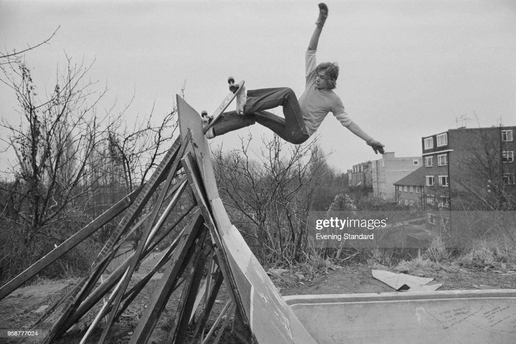 A skateboarder attempting a frontside blunt on a ramp, London, UK, 11th January 1978.