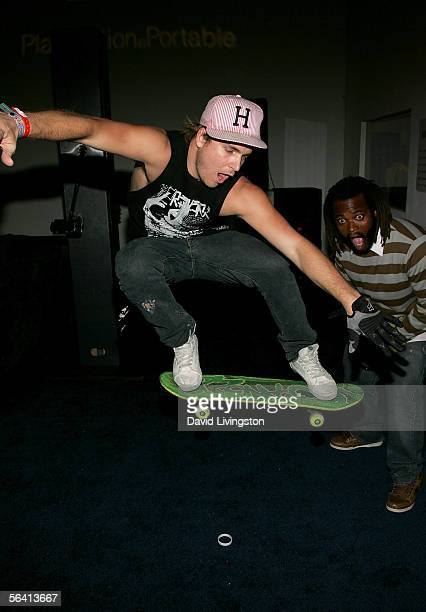 Skateboarder Chad Muska performs a trick as Sal Masekela looks on as they attend Playstation BANDtogether, a benefit presented by Sony Computer...