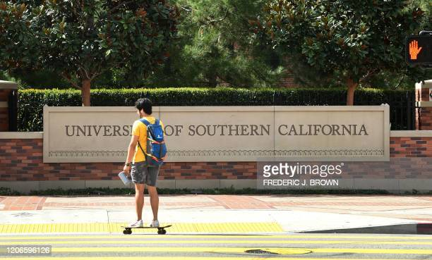 A skateboarder commutes at the University of Southern California in Los Angeles California on March 11 where a number of southern California...