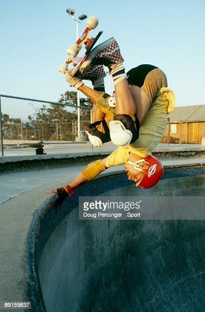 A skateboarder does an invert in the round pool section of the combi pool at the Upland Skate Park in August 1984 in Upland California