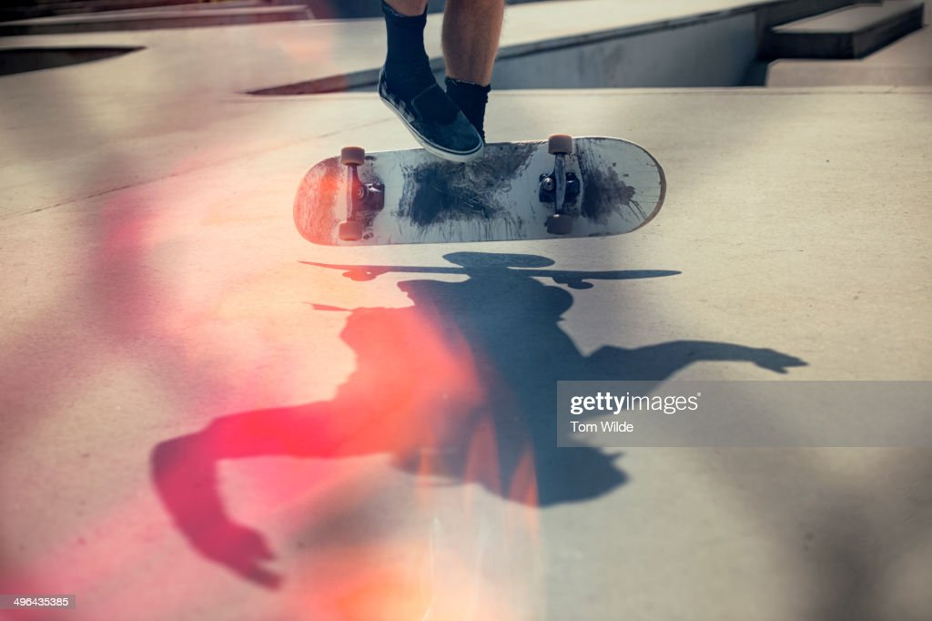 Skateboarder doing an Ollie : Stock Photo