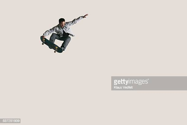 skateboarder doing big air & tail grabbing - sporting term stock pictures, royalty-free photos & images