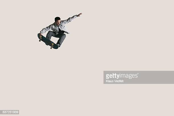 skateboarder doing big air & tail grabbing - skateboard ストックフォトと画像