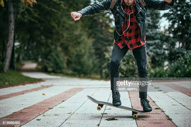 Skateboarder doing jumps