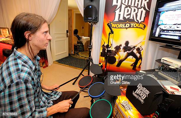 Skateboarder Erik Ellington poses with the Activision / RedOctane display during the HBO Luxury Lounge in honor of the 60th annual Primetime Emmy...