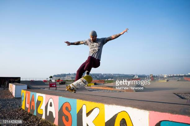 A skateboarder exercises alone on Cardiff Bay barrage on March 24 2020 in Cardiff United Kingdom British Prime Minister Boris Johnson announced...