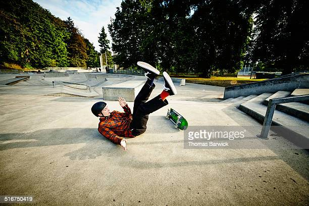 skateboarder falling off of railing in skate park - 失敗 ストックフォトと画像