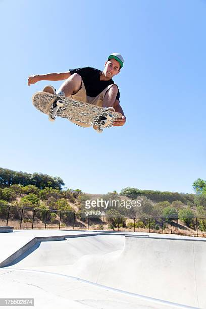 skateboarder flying through air - gchutka stock pictures, royalty-free photos & images