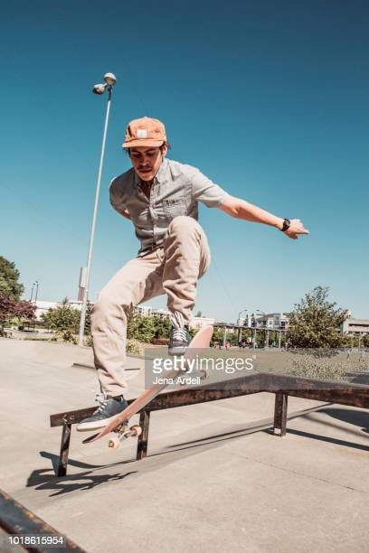 skateboarder in air, skateboarder jumping, skateboarder jump at skatepark - khaki trousers stock pictures, royalty-free photos & images