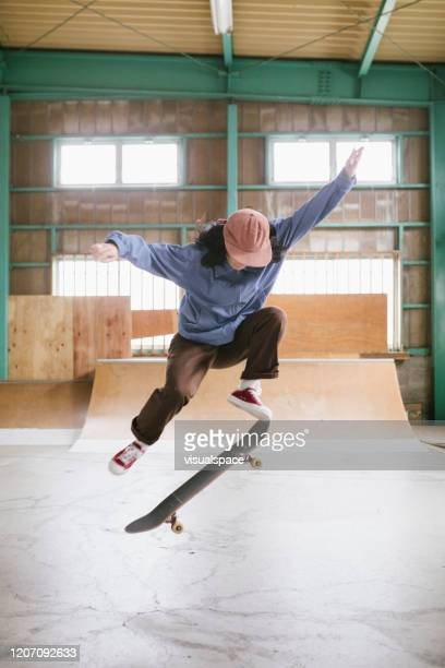 skateboarder in mid-air ollie - ollie pictures stock pictures, royalty-free photos & images