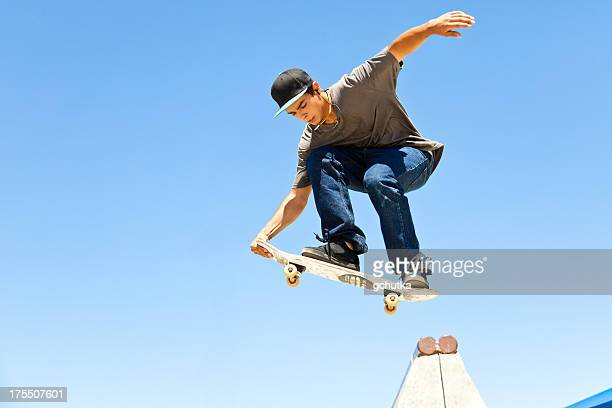 skateboarder in mid-air - clear sky stock pictures, royalty-free photos & images
