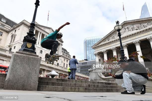 Skateboarder is filmed doing a trick outside the Bank of England in central London on September 2, 2021.