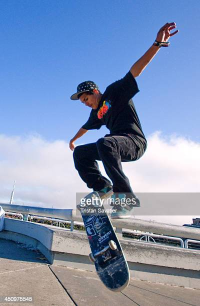 CONTENT] Skateboarder jumping at the annual Superhero Street Fair in San Francisco skateboarding skateboard board jumping sport Skateboarding trick...